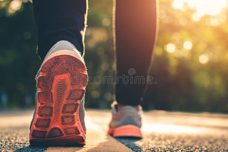 Close up foot women run feet on road in workout wellness.  stock photo