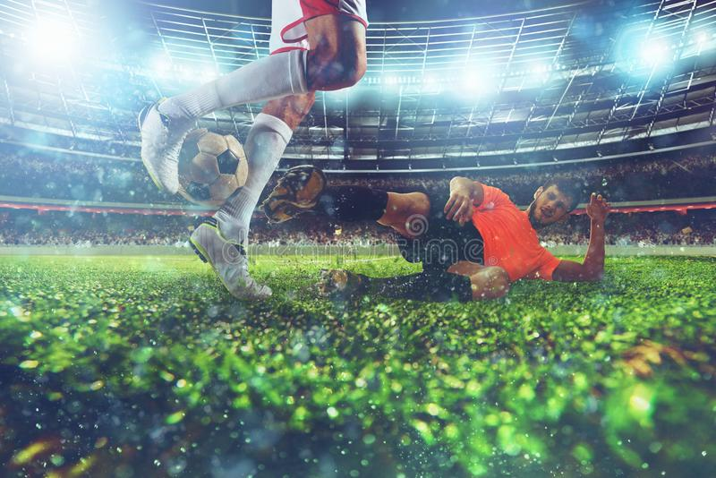 Close up of a football action scene with competing soccer players at the stadium during a night match royalty free stock photo