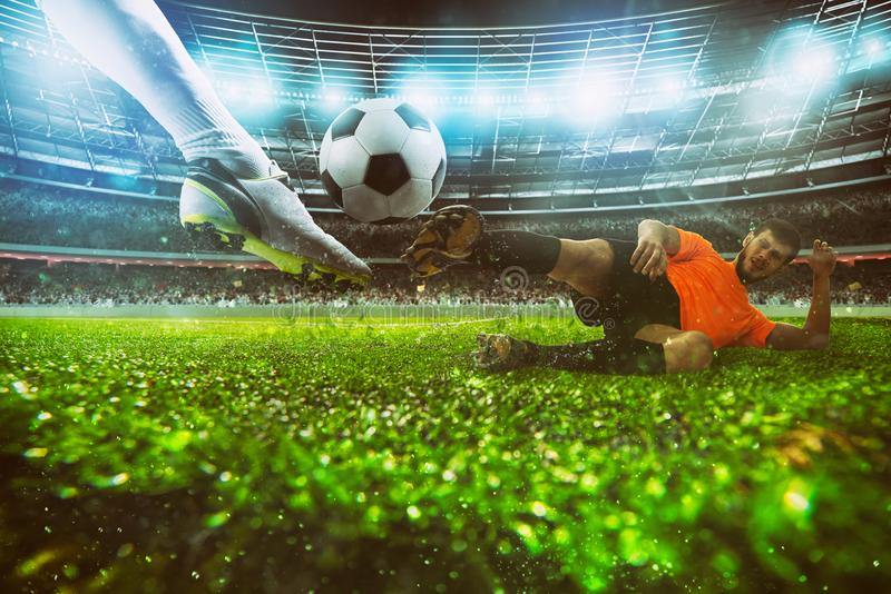 Close up of a football action scene with competing soccer players at the stadium during a night match stock photography
