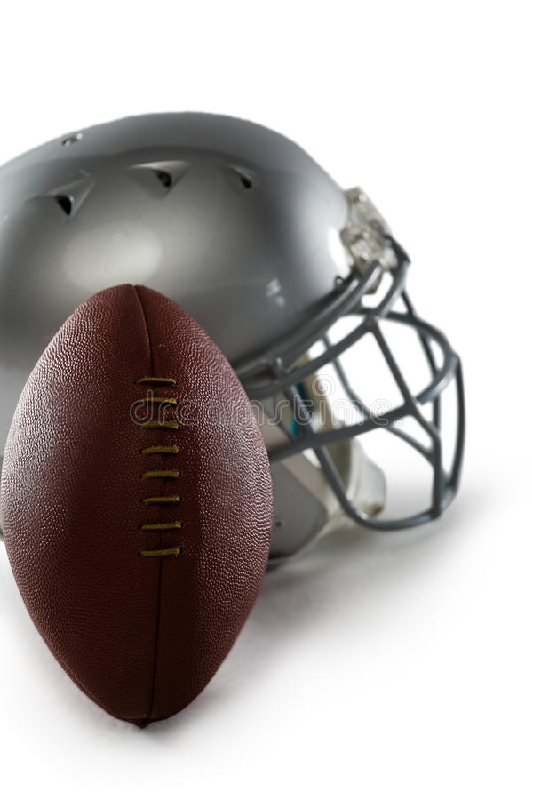 Close-up of football and sports helmet. Against white background royalty free stock photography