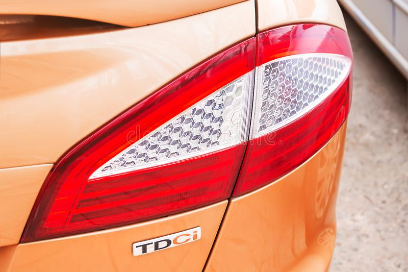 Close-up of a Ford rear light and the TDCI logo, indicating that this car has the turbo diesel with common rail injection engine royalty free stock photos