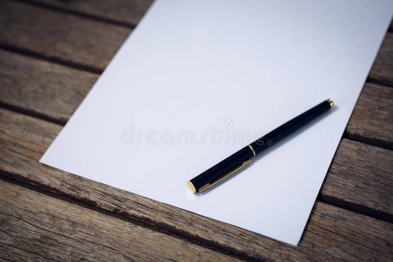 Close up of fountain pen with paper. At table stock photos