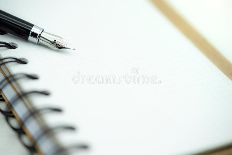 Close up fountain pen on paper  on a white background stock photo