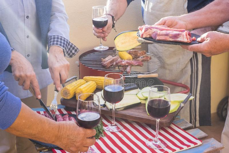 Close up four age seniors doing barbeque stock photo