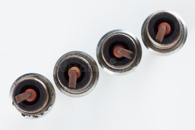 Close-up four old burned spark plugs royalty free stock photo