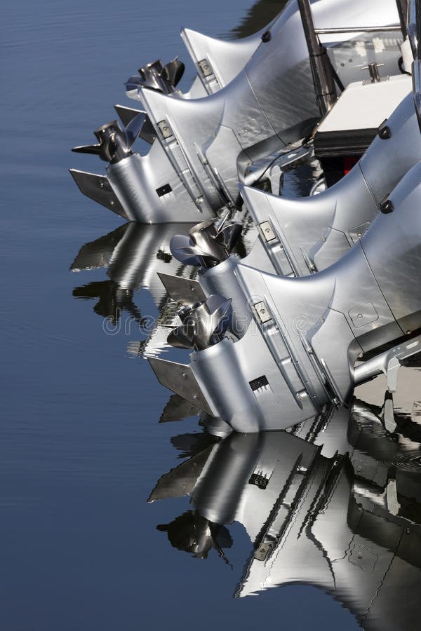 Close up of four outboard boat motors. And propellers royalty free stock photography