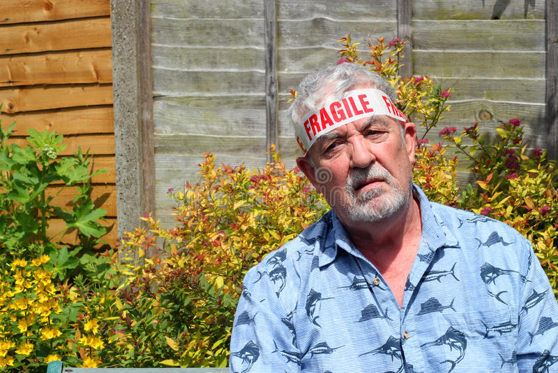 Close up of a fragile senior man. stock image
