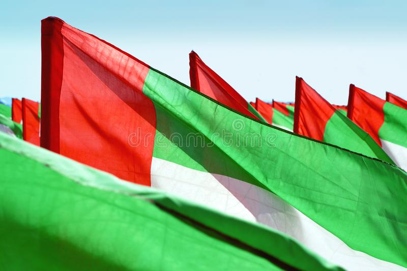 Close up fragment of waving UAE flags. Close up fragment of waving flags of United Arab Emirates fluttering in the wind. United Arab Emirates independence day stock images