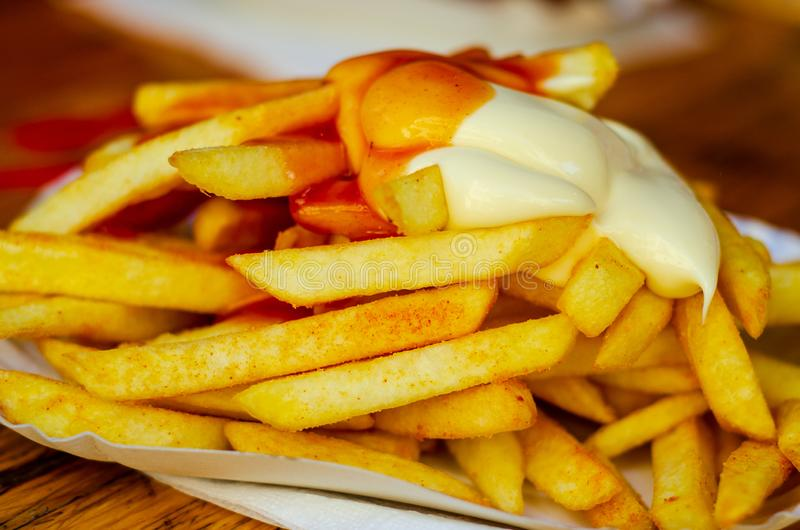 Close-up of french fries with ketchup and mayo royalty free stock photography