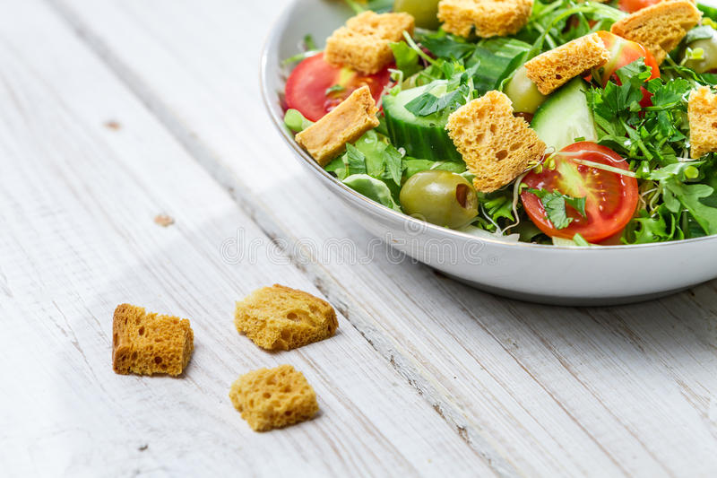 Close-up on a fresh Caesar salad made of vegetables royalty free stock image