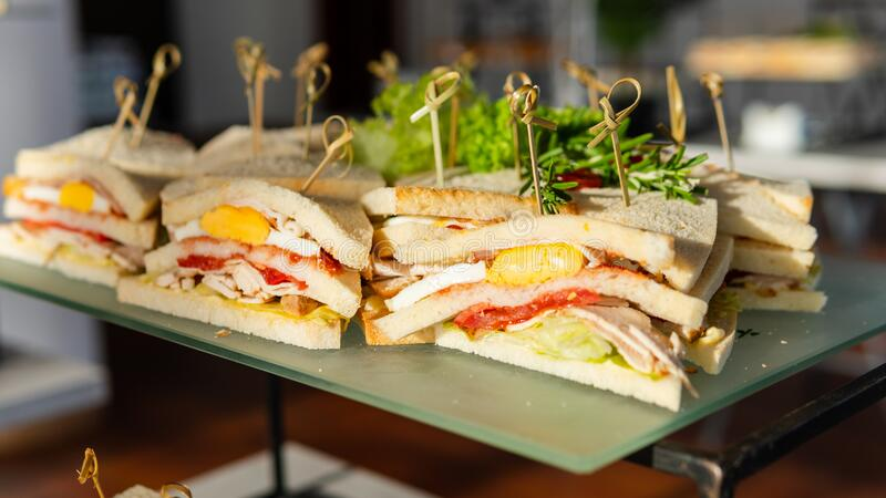 Close-up of fresh club sandwich. Concept of  takeaway food and catering service royalty free stock photography