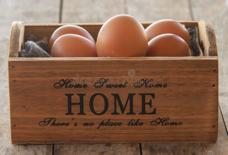 Close up fresh eggs. On wood royalty free stock photo