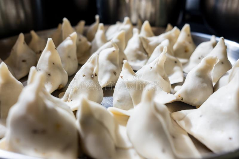 Close up of fresh homemade samosas in kitchen in preparation, samosas are a staple of indian diet and a classic street food stock image
