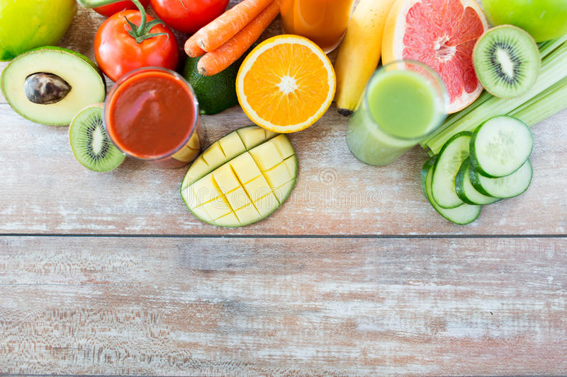 Close up of fresh juice glass and fruits on table. Healthy eating, food and diet concept - close up of fresh juice glass and fruits on table stock image