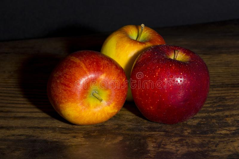 Braeburn apples on a wooden table stock image