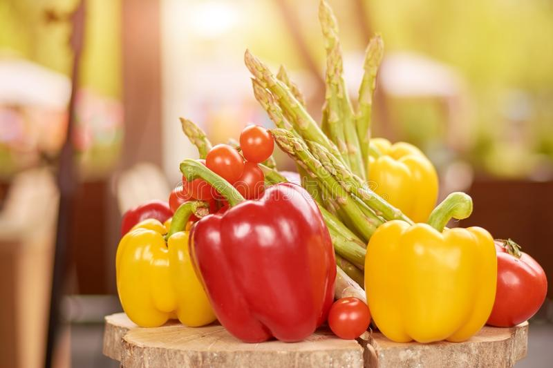 Close up of fresh peppers, asparagus, cherry tomatoes. stock image