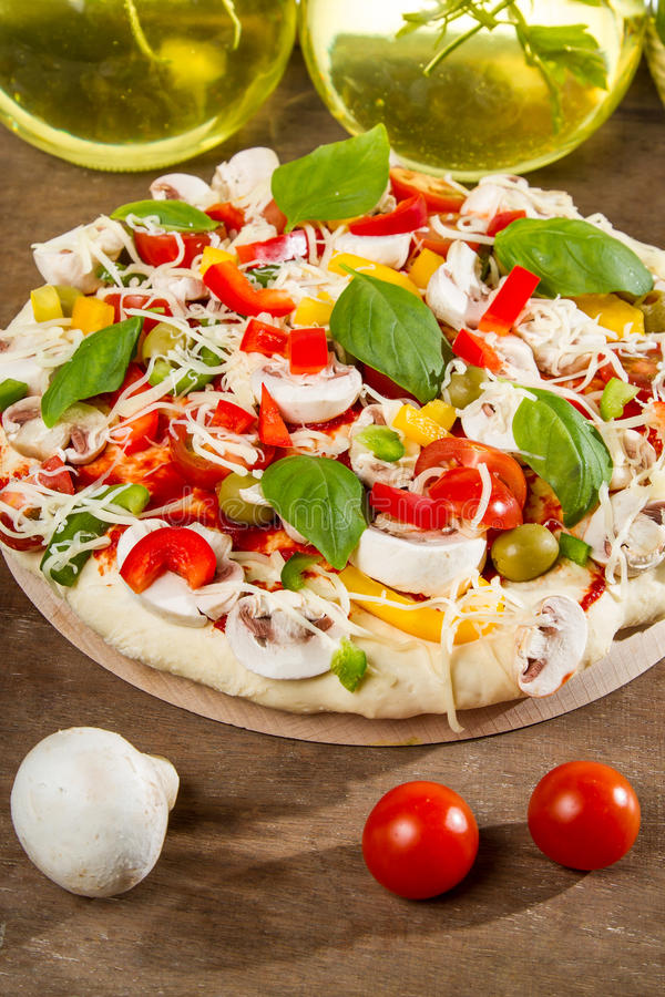Close-up of fresh pizza before baking royalty free stock photo