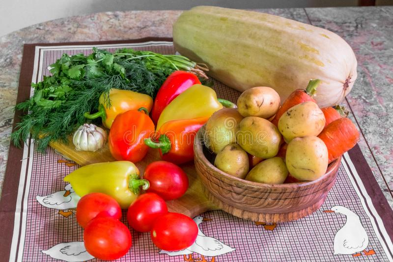 Kitchen still life. Fresh raw vegetables on the table. royalty free stock images