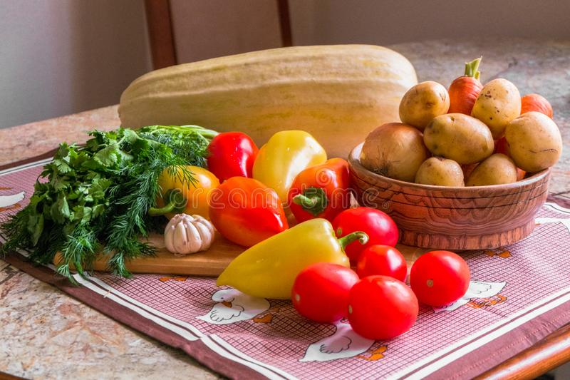 Kitchen still life. Fresh raw vegetables on the table. stock images
