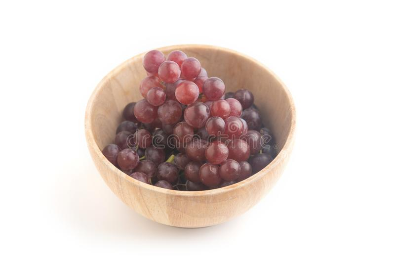 Fresh red grape isolated on white background. Close up fresh red and purple grape on white background stock photos