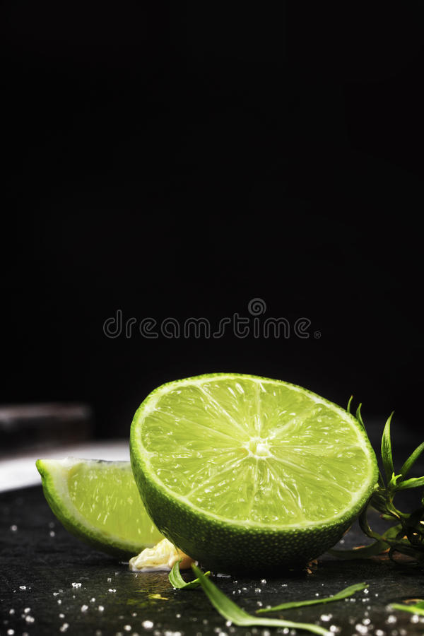 Close-up of fresh, ripe, juicy half of a green lime on a black background. Citrus fruit full of vitamins. Copy space. royalty free stock image