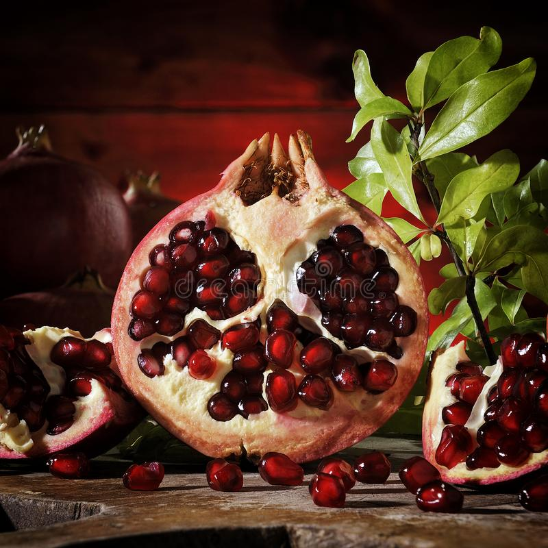 Close up of fresh ripe pomegranates royalty free stock photos