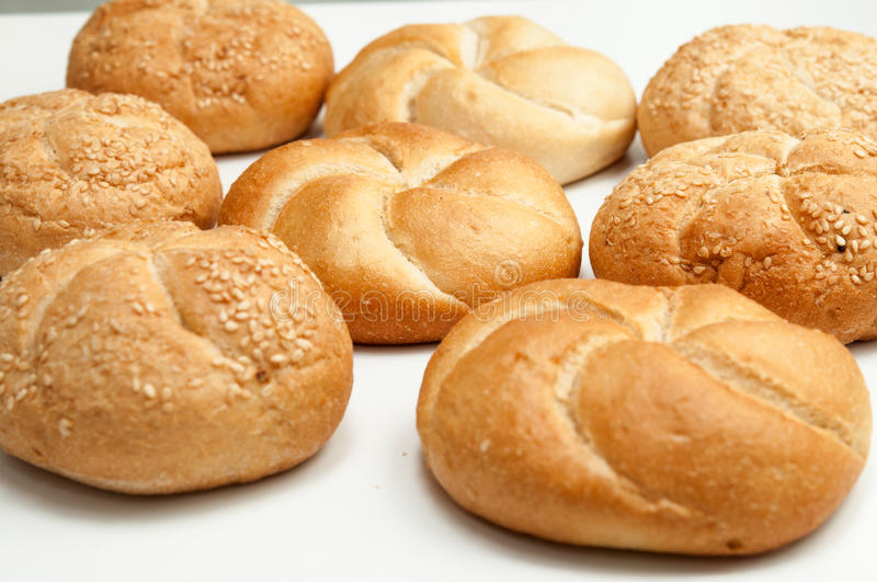 Close up of fresh rolls bread with sesame seeds from the oven. Close up of fresh rolls bread with sesame seeds from oven royalty free stock image