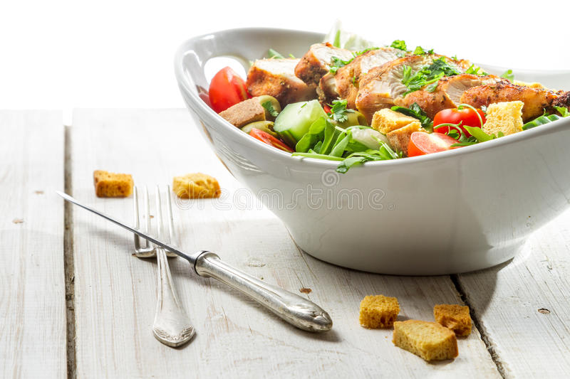 Close-up on a fresh salad with chicken stock photos