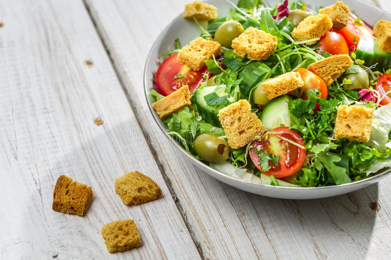 Close-up on a fresh salad with chicken stock image