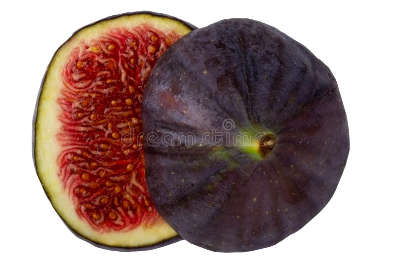Close-up of a fresh sliced ripe purple fig fruit isolated on a w royalty free stock image
