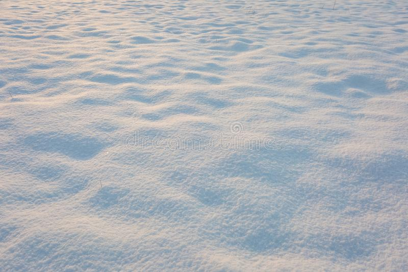 Close up of fresh snow lying on field. Snow background. Close up of fresh snow lying on field. Christmas background stock image