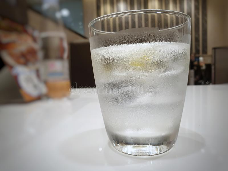 Close Up of fresh water in a glass on white table in restaurant royalty free stock photo