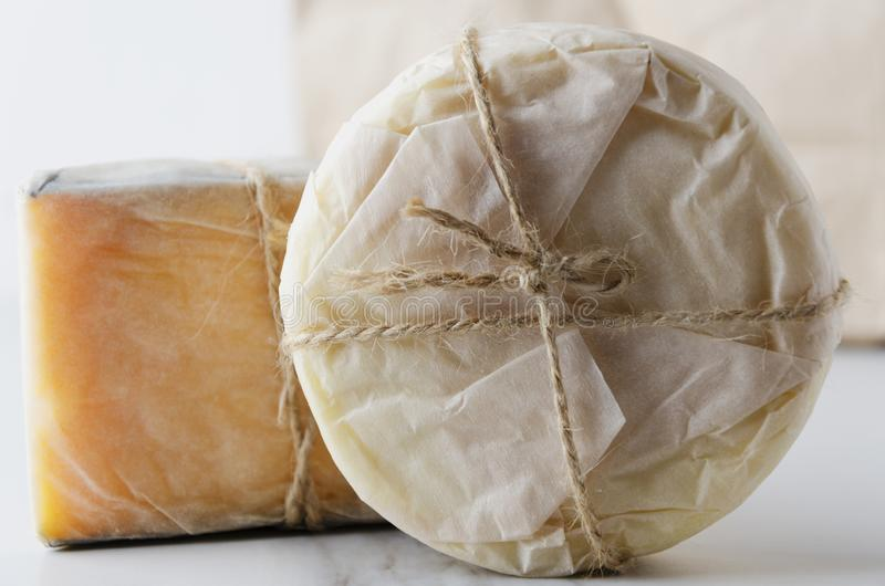 Close up of fresh wrapped in paper cheese.Traditional italian cheese.Various typies of cheese royalty free stock photo