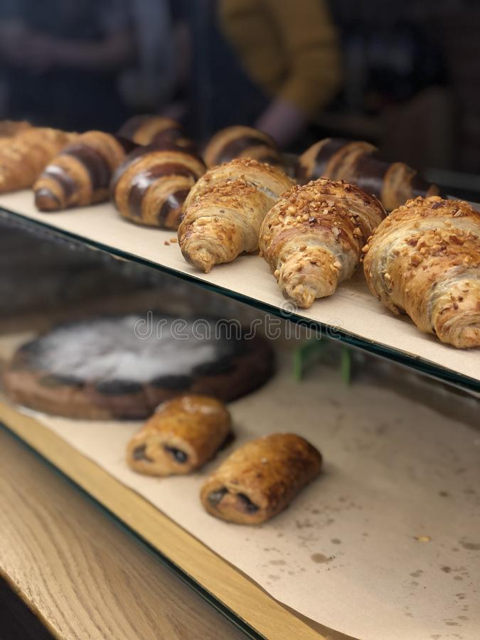 Close up freshly baked croissants from the oven ready to sale. stock photo