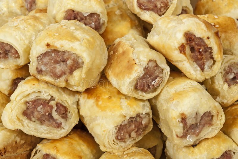 Close up Freshly Baked Homemade Cocktail Sausage Rolls stock image