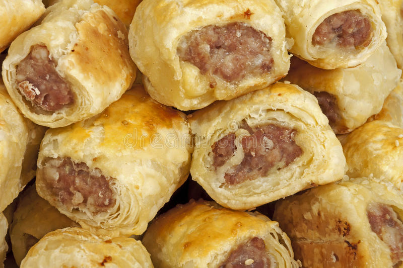 Close up Freshly Baked Homemade Cocktail Sausage Rolls stock photos