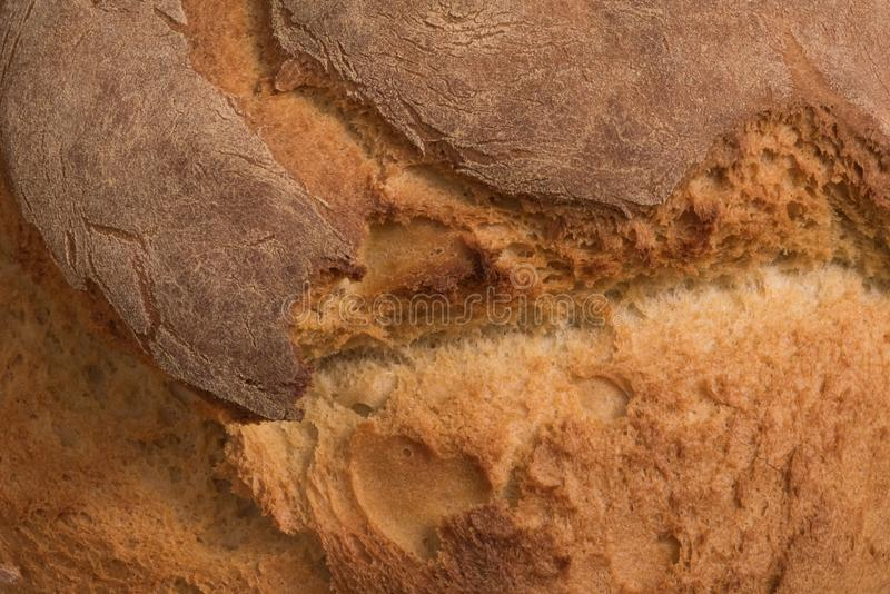 Close up of a freshly cracked bread surface stock photography