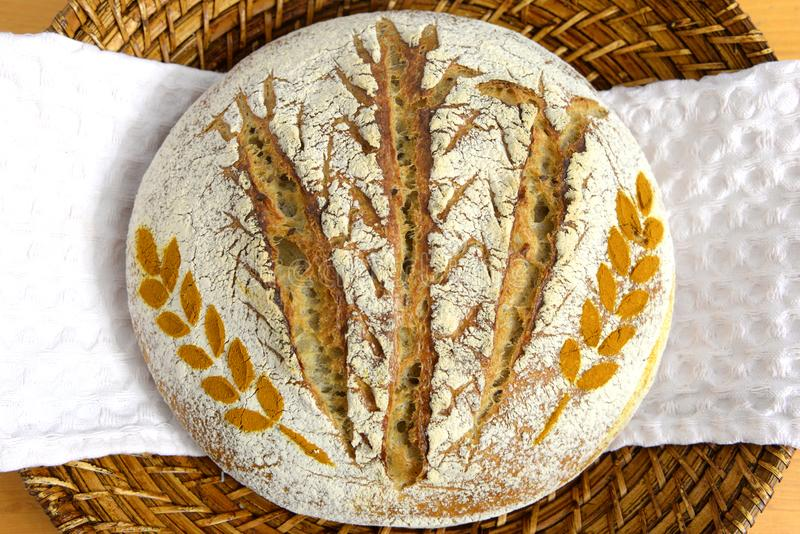 Sourdough bread decorated with wheat spice in a basket stock photo