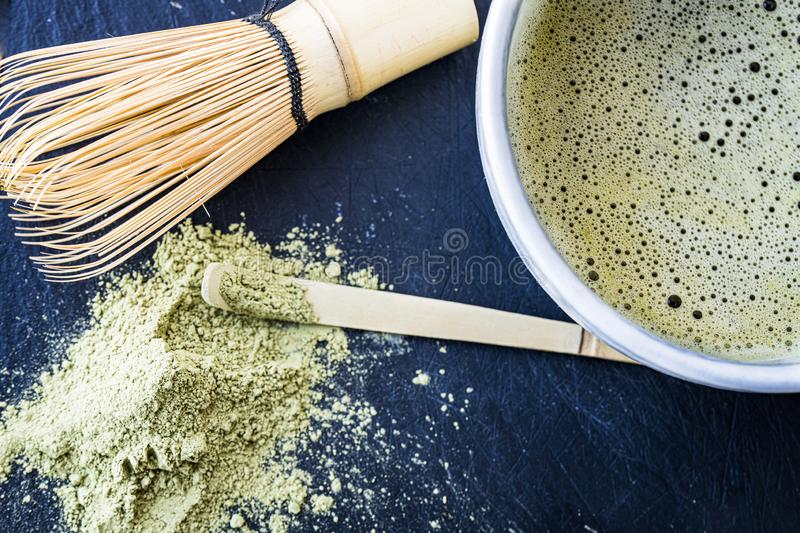 A close of freshly made matcha green tea and tools royalty free stock images
