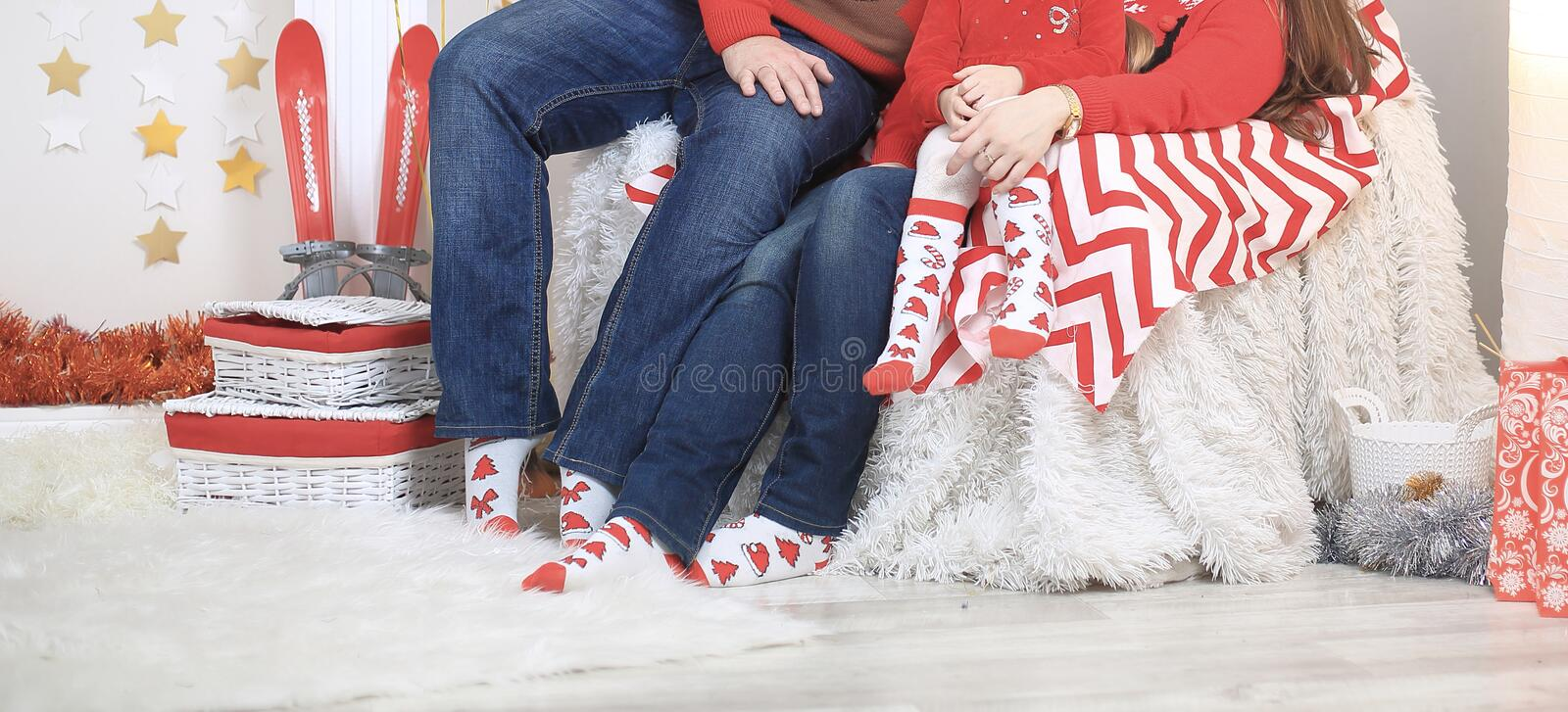 Close up.a friendly family sitting on the couch on Christmas eve royalty free stock photography