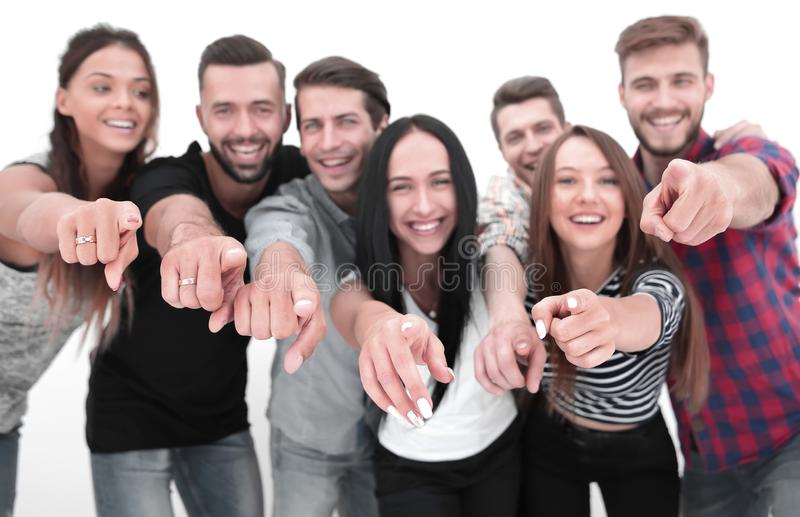 Close up.a friendly team of young men pointing at you stock photo