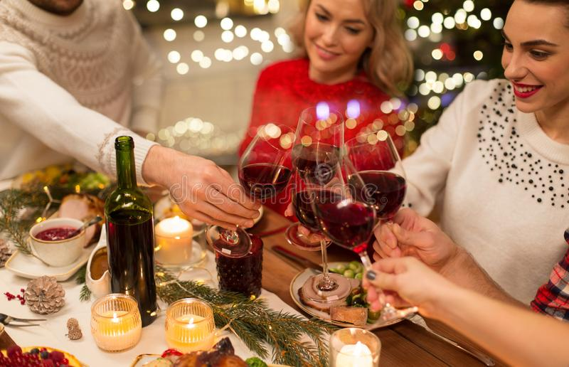 Close up of friends with wine celebrate christmas stock photos