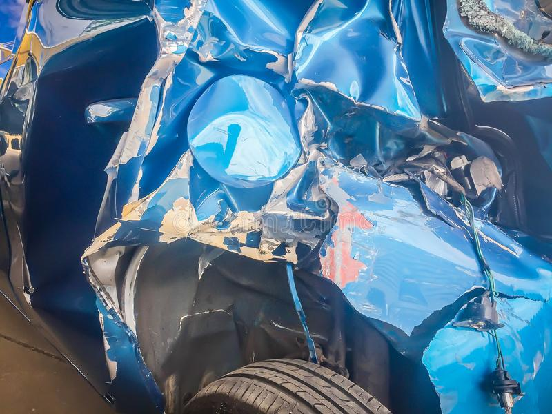 Close-up front of blue new car distorted by accident. Crashed ne. W blue car severely damaged and needs help for move to the garage to repair and call to loss royalty free stock photo
