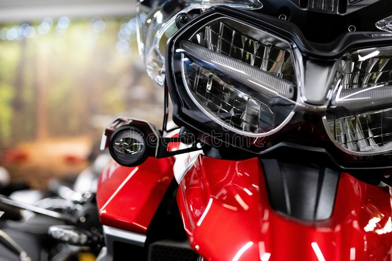 Close up of the front of a brand new enduro motorcycle, soft focus, abstract background - Image stock photos