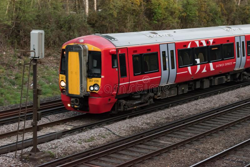 Close up of the front carriage of a Gatwick Express train service at a signal as it passes on the way to Gatwick Airport stock photos