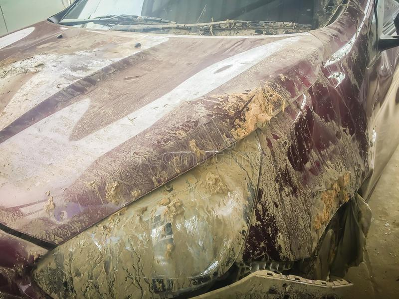 Close-up front of dirty car distorted by accident. Crashed dirty. Car severely damaged and needs help for move to the garage to repair and call to loss adjuster stock photography