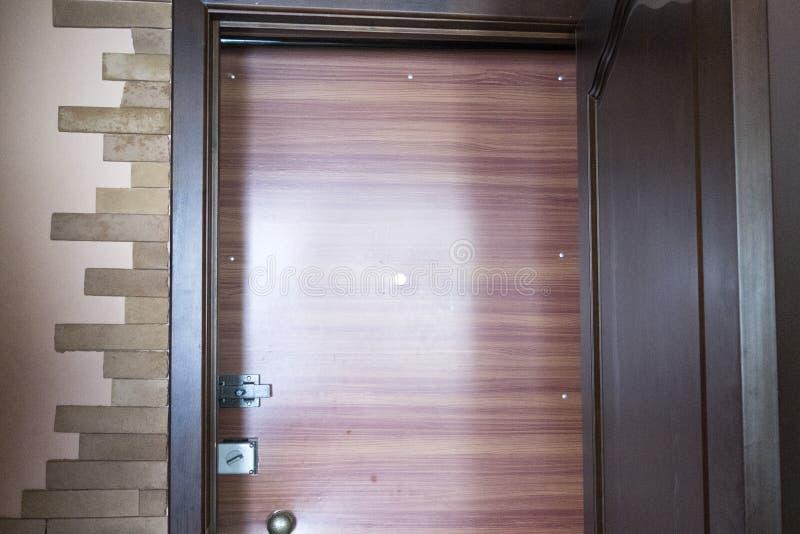 Close-up front door. Two door locks and door handle stock photo