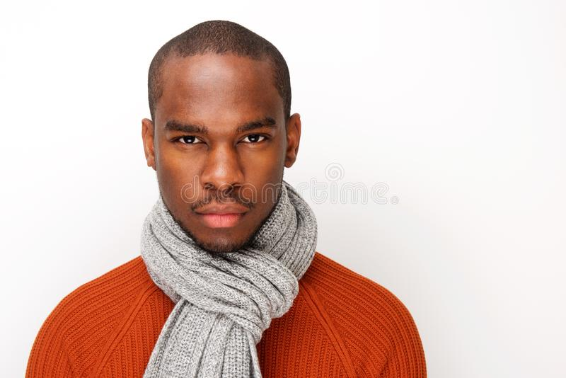 Front portrait of handsome young black man with scarf posing against white background royalty free stock image