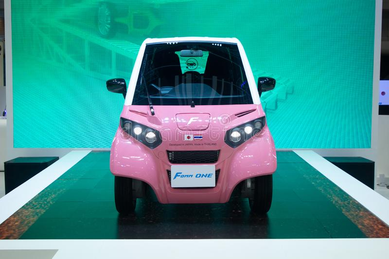 Thailand - Dec , 2018 : close up front view of Fomm one pink colo electricity car presented in motor expo Nonthaburi Thailand. Close up front view of Fomm one royalty free stock photography