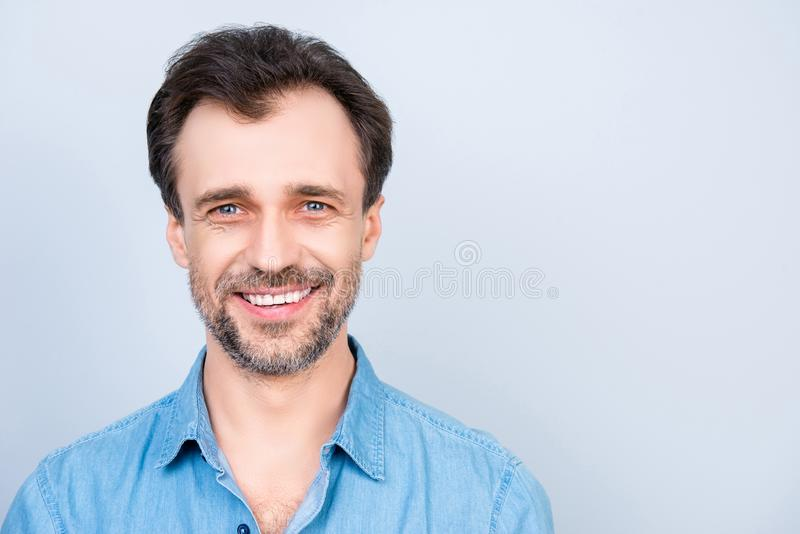 Close up front view portrait of mature cheerful excited satisfied glad virile masculine man wearing jeans denim shirt isolated on royalty free stock images